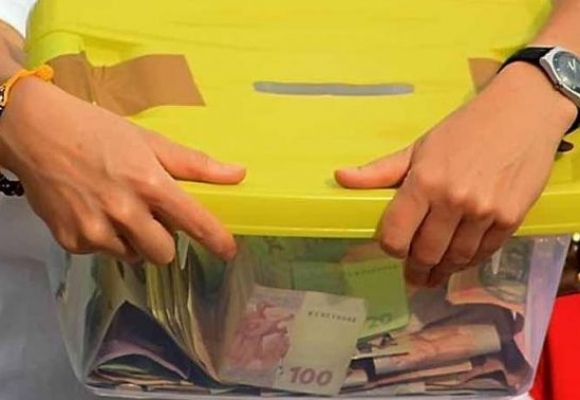 У Виноградові жінка поцупила з аптеки скриньку для пожертв