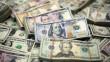 Долар продовжує дешевшати: прогнози експертів